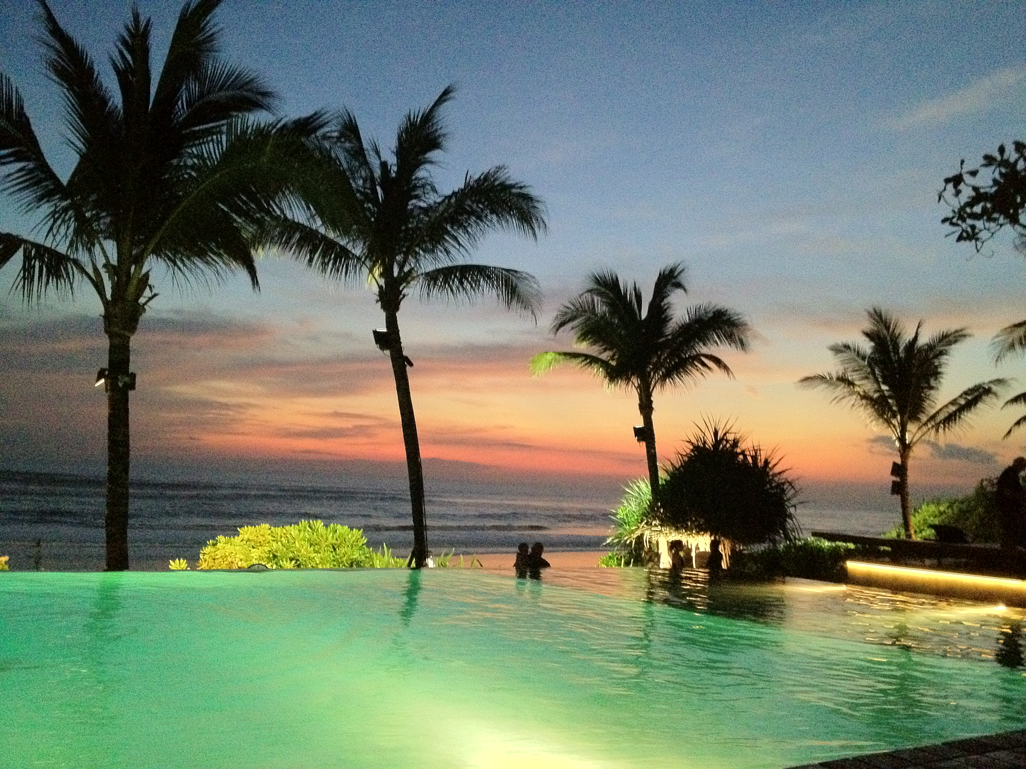 Sunset and infinity pool at Potato Head Beach Club in Seminyak, Bali.
